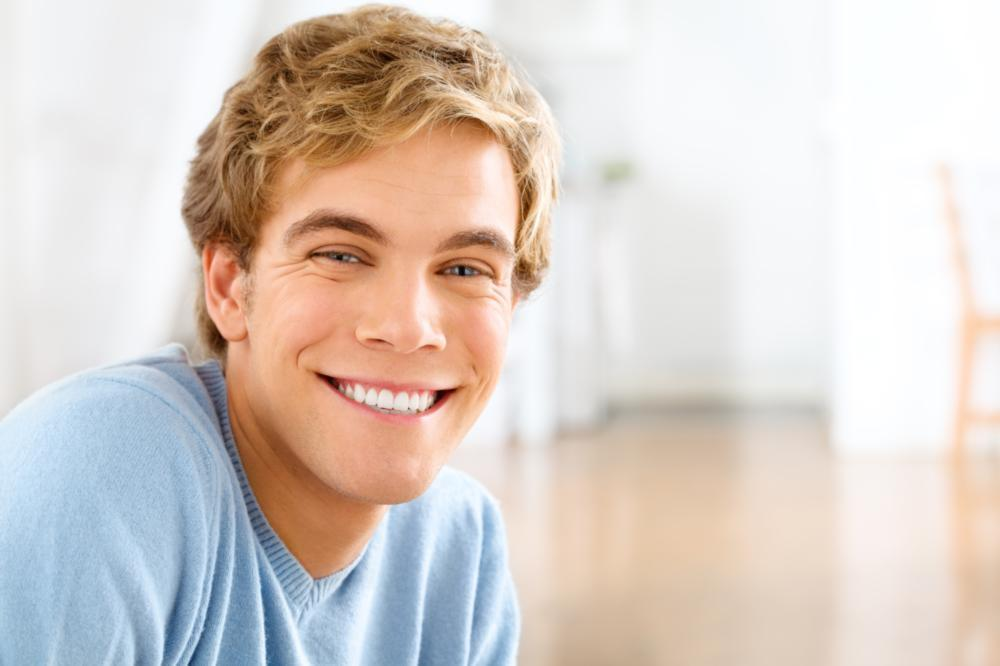 Man smiling in blue shirt | Dentist Glendale Ca