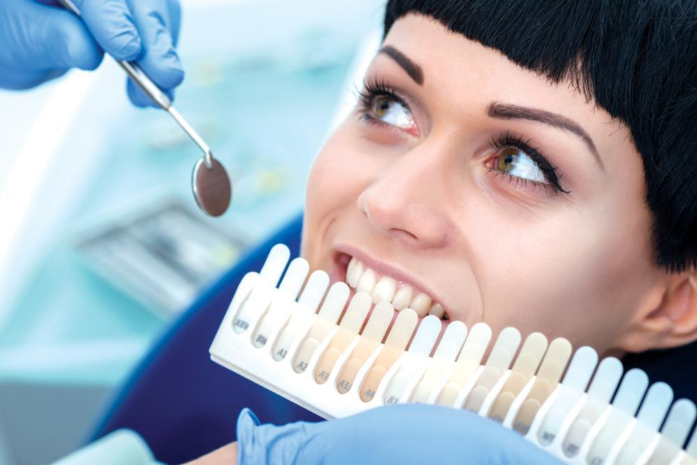 woman getting teeth whitened | Dentist Glendale CA