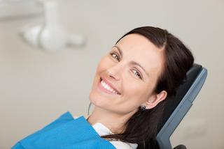 Woman smiling in dental exam chair at Glendale dentist