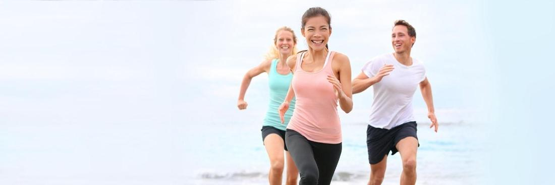 adults running on beach | Dentist Glendale CA