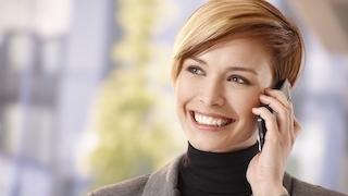Woman talking on cellphone | Dentist Glendale CA