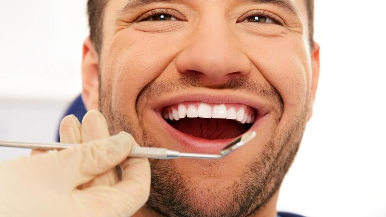 Man getting dental care | Second Opinions by Dr Lucio H. Kim, DDS, Glendale CA