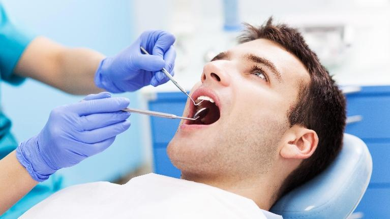 Man Have Teeth Examined | Lucio H. Kim DDs
