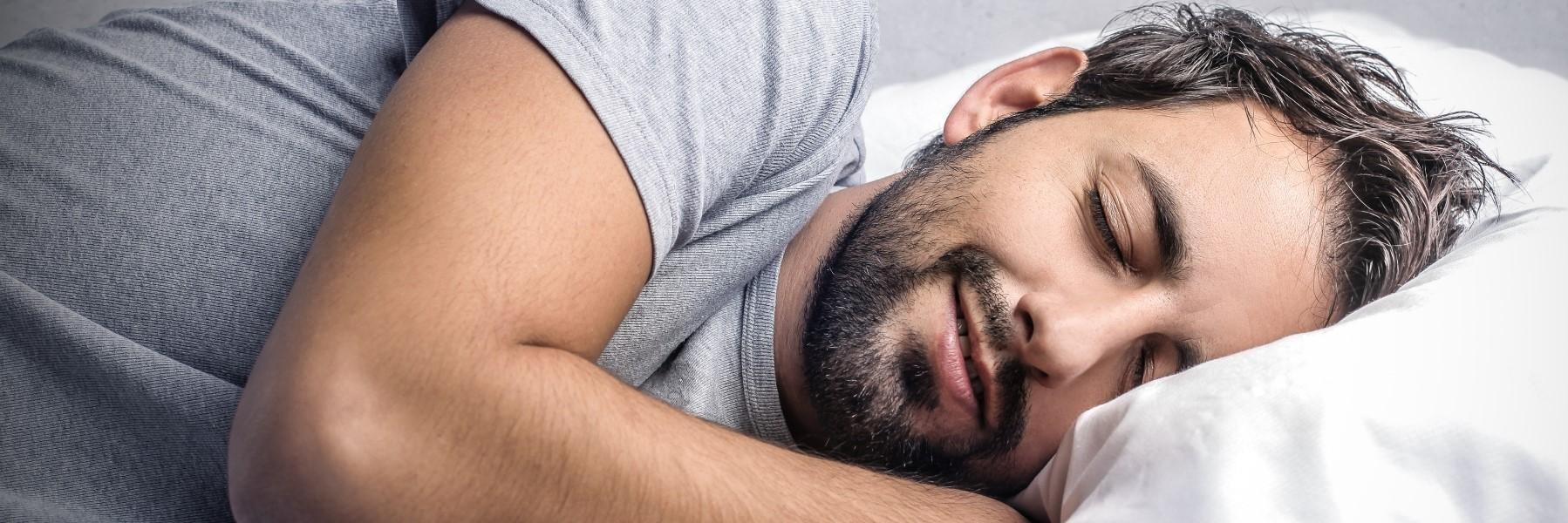 man sleeping soundly with a night guard